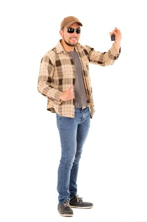 positive man with flannel shirt and cap