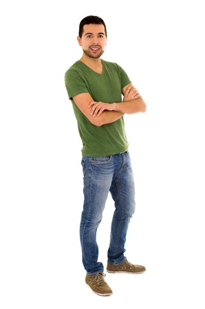 casual wear: young man jeans green t-shirt standing crossing arms isolated on white
