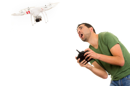 flying man: man flying quadcopter drone isolated on white