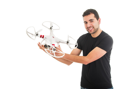 handsome young man holding quadcopter drone isolated on white Stok Fotoğraf - 46516809