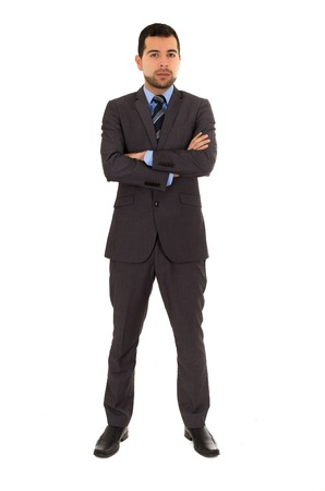 crossing arms: hispanic young man wearing grey suit standing crossing arms isolated on white