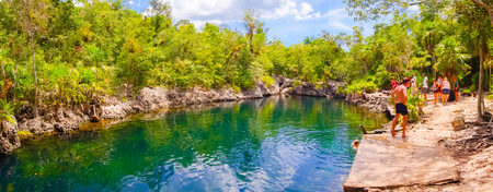 cave exploring: BAY OF PIGS, CUBA - SEPTEMBER 9, 2015:  Tourist attraction for swimming in Cueva de los Peces,  seaside cave with tropical fish. Editorial