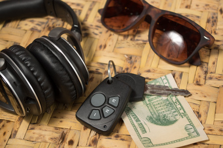 Personal belongings of typical woman, daily life concept, mobile phone, car keys, glasses and money spread out. Stock Photo