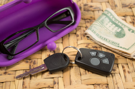 personal accessory: Personal belongings of typical woman, daily life concept, mobile phone, car keys, glasses and money spread out. Stock Photo