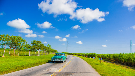 capitolio: CENTRAL ROAD, CUBA - SEPTEMBER 06, 2015: American Oldtimer in the rural road system used for transportation Editorial