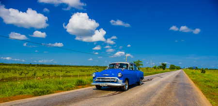 CENTRAL ROAD, CUBA - SEPTEMBER 06, 2015: American Oldtimer in the rural road system used for transportation Editorial