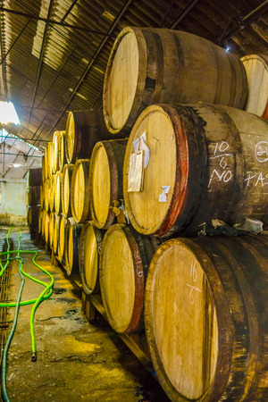 pinar: PINAR DEL RIO, CUBA - SEPTEMBER 13, 2015: Guayabita rum and alcoholic beberages factory in the city centre Editorial