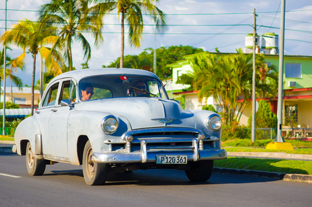 CIENFUEGOS, CUBA - SEPTEMBER 12, 2015: An Old American Car in the center of ths City.