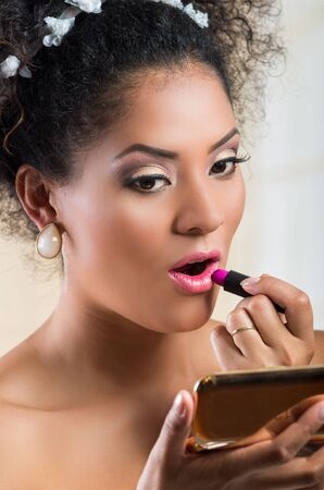 applying lipstick: Closeup portrait of beautiful hispanic bride applying lipstick on Stock Photo