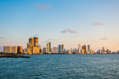 Beautiful view of Cartagena, Colombia behind the blue ocean during sunset Stock Photo
