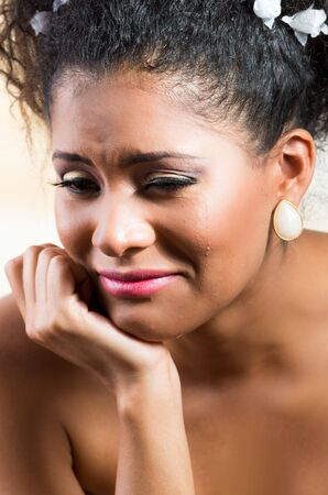 inconsolable: Closeup portrait of beautiful exotic emotional bride crying