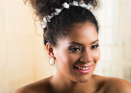 black makeup: Beautiful exotic young girl wearing a floral hairband. Closeup portrait