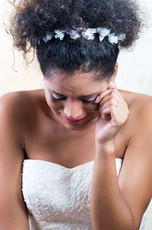 heartbroken: Closeup portrait of beautiful heartbroken emotional bride crying Stock Photo