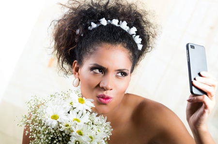 love pic: Closeup portrait of beautiful exotic emotional bride taking a selfie Stock Photo