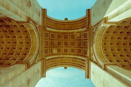 triumphe: Arc de Triomphe de lEtoile, Triumphal Arc of the Star, Paris, France. Low angle shot Stock Photo