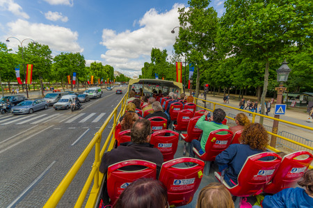 PARIS, FRANCE - JUNE 1, 2015: Beautiful summer view from touristic bus of the Champs Elysees Editorial