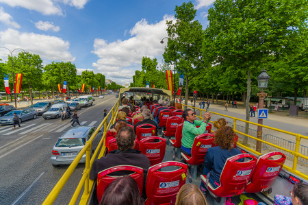 elysees: PARIS, FRANCE - JUNE 1, 2015: Beautiful summer view from touristic bus of the Champs Elysees Editorial