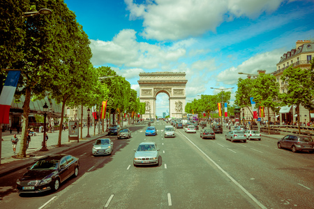 champs elysees: PARIS, FRANCE - JUNE 1, 2015: Beautiful summer colorful view of Champs Elysees with Arc de Triomphe in the background Editorial