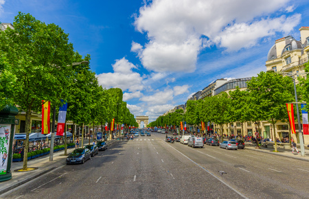elysees: PARIS, FRANCE - JUNE 1, 2015: Beautiful view of Champs Elysees boulevard with Arc de Triomphe in the background Editorial