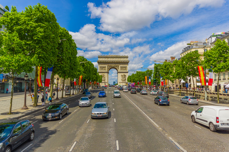 elysees: PARIS, FRANCE - JUNE 1, 2015: Beautiful summer colorful view of Champs Elysees with Arc de Triomphe in the background Editorial