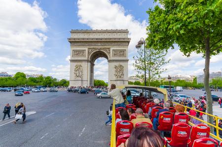 triumphe: PARIS, FRANCE - JUNE 1, 2015: City tour bus with tourists in Champs Elysees and Arc de Triomphe Editorial