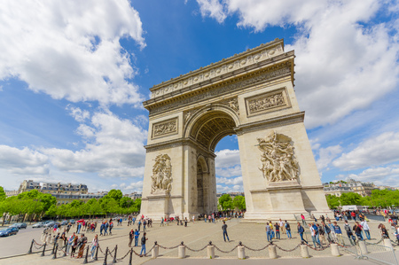 champs elysees: PARIS, FRANCE - JUNE 1, 2015: Beautiful summer view of Champs Elysees and Arc de Triomphe with visiting tourists Editorial