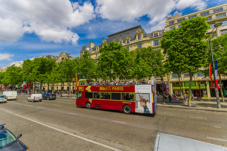 elysees: PARIS, FRANCE - JUNE 1, 2015: Beautiful summer view of a tour bus  in the Champs Elysees