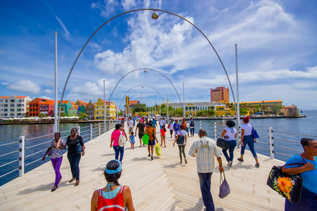 WILLEMSTAD, CURACAO - NOVEMBER 1, 2015:  Queen Emma Bridge in front of the Punda district, is a pontoon bridge across St. Anna Bay