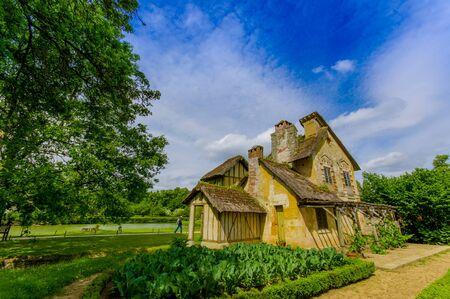 Hameau de la Reine, The Queen's Hamlet is a rustic retreat in Versailles, Paris, France 写真素材