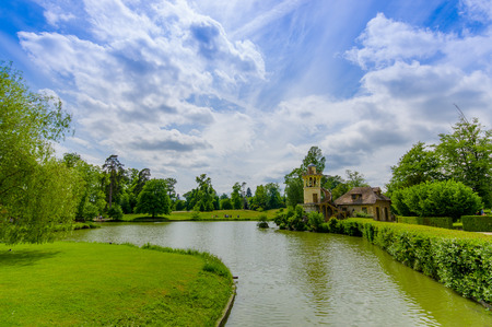 Beautiful lake view in the Hameau de la Reine, The Queen's Hamlet is a rustic retreat in Versailles, Paris, France