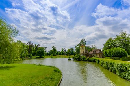 retreat: Beautiful lake view in the Hameau de la Reine, The Queens Hamlet is a rustic retreat in Versailles, Paris, France