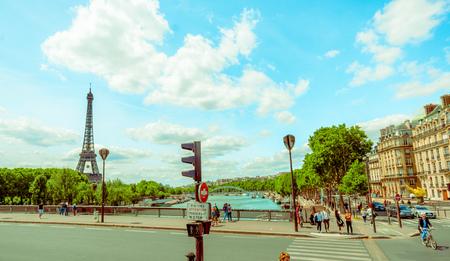 parisian scene: PARIS, FRANCE - JUNE 1, 2015: Beautiful parisian scene with Seine river and Eiffel Tower Editorial