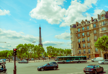 parisian scene: PARIS, FRANCE - JUNE 1, 2015: Beautiful parisian scene with Eiffel tower in the background
