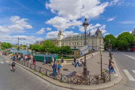 cite: PARIS, FRANCE - JUNE 1, 2015: Tourists visiting Ile de la Cite island in the center of Paris, where the medieval city was refounded.