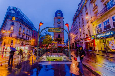 france station: PARIS, FRANCE - JUNE 1, 2015: Metropolitain subway metro station entrance on a typical rainy evening. Editorial