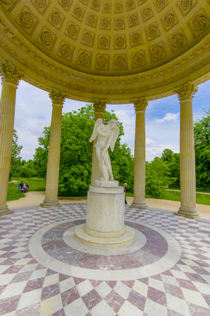 love dome: PARIS, FRANCE - JUNE 1, 2015: The Temple of Love, located in the gardens behind Le Petit Trianon in Versailles Editorial