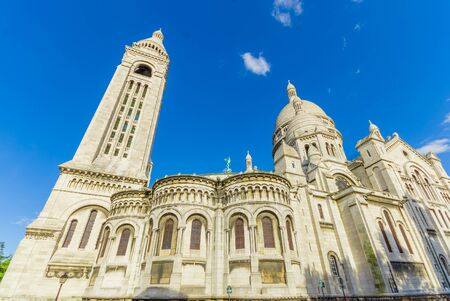 Impressive Basilica of the Sacred Heart of Paris, Sacre Coeur located in Montmartre hill, Paris, France Imagens