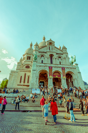 impressive: Paris, France - June 1, 2015: Tourists visiting the impressive Basilica of the Sacred Heart of Paris, Sacre Coeur located in Montmartre hill Editorial