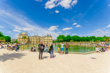 french model: Paris, France - June 1, 2015: Lake with sailing model in Luxembourg Palace, seat of the French State of the Fifth Republic Editorial