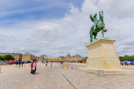 louis the rich heritage: Paris, France - June 1, 2015: Equestrian statue of King Louis XIV by Pierre Cartellier and Louis Petitot, located in the entrance of Palace of Versailles