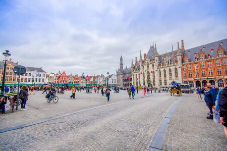 countless: Bruges, Belgium - 11 August, 2015: Famous plaza Markt in city centre, sorrounded by stunning architecture and countless markets. Editorial