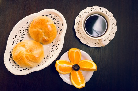 cereal bar: Elegant breakfast concept seen from above, coffee cup, bread and sliced oranges. Stock Photo