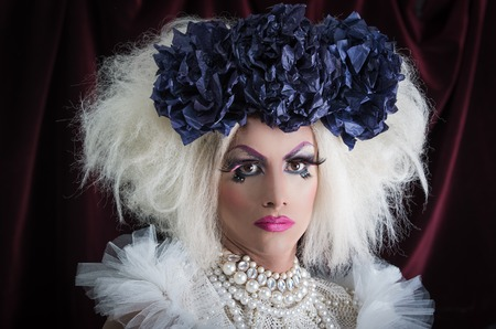 trashy: Drag queen with spectacular makeup, glamorous trashy look, posing happily and charming camera.