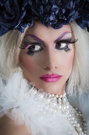 trashy: Drag queen with spectacular makeup, glamorous trashy look, posing serious facial expression.