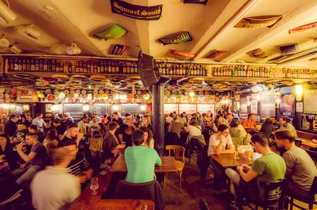 delirium: BRUSSELS, BELGIUM - 11 AUGUST, 2015: Famous Delirium Bar inside overview crowded room of people enjoying their beers.