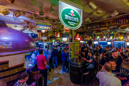 delirium: BRUSSELS, BELGIUM - 11 AUGUST, 2015: Famous Delirium Bar inside overview of crowded room of people enjoying their beers.