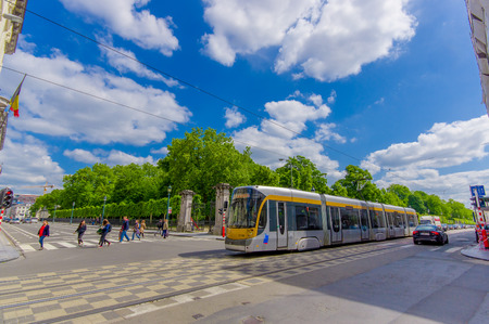 day light: BRUSSELS, BELGIUM - 11 AUGUST, 2015: Blue tram passing by Palace of the Nation on a beautiful sunny day. Editorial