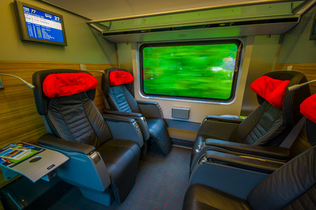 seating area: Vienna, Austria - 11 August, 2015: Inside business class seating area on the train,  large black leather seats.