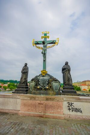 famous statues: Prague, Czech Republic - 13 August, 2015: Famous Charles Bridge and one of its many famous statues placed alongside it. Editorial