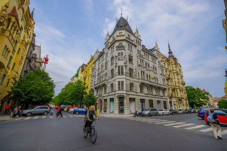 victorian architecture: Prague, Czech Republic - 13 August, 2015: Very nice city block with beautiful facades and bridgestone road, typical european victorian architecture.